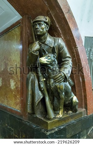 MOSCOW, RUSSIA - AUGUST 23, 2014: Sculpture at the subway station Revolution Square in Moscow. Having been in this place people rub the dog's nose for good luck - stock photo