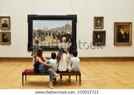 MOSCOW, RUSSIA - AUGUST 7, 2014:State Tretyakov Gallery is art gallery in Moscow and is foremost depository of Russian fine art in world. Gallery's history starts in 1856. Hall of artist I. Repin - stock photo