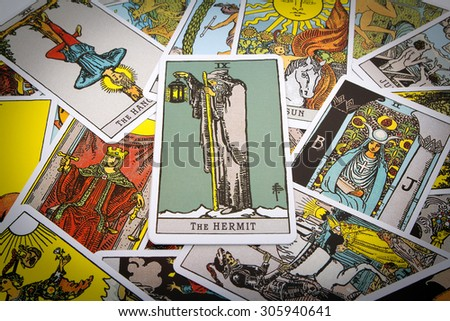Moscow, Russia-August 13, 2015:Tarot cards Tarot, the hermit card in the foreground.
