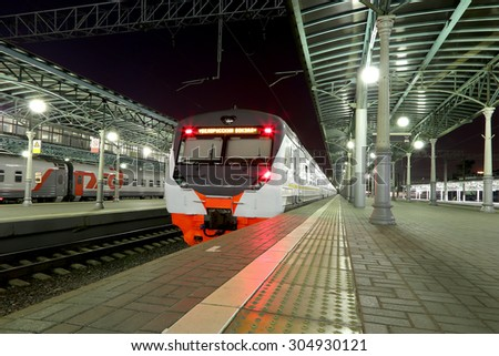 "MOSCOW, RUSSIA - AUGUST, 08 2015:Train on Moscow passenger platform at night (Belorussky railway station)  in Moscow, Russia. Inscribed on the train ""Belorussky railway station"" in Russian - stock photo"