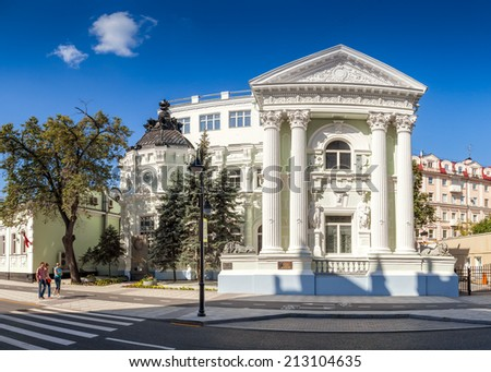 MOSCOW, RUSSIA - AUGUST 24 2014: Von Rekk mansion at Pyatnitskaya street with locals and tourists walking. Moscow city government reconstruct street conception and made it pedestrianized at holidays - stock photo