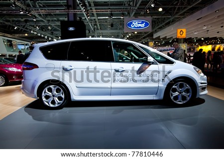 MOSCOW, RUSSIA - AUGUST 25:  White Ford C-Max on display at Moscow International exhibition InterAuto on August 25, 2010 in Moscow, Russia. - stock photo