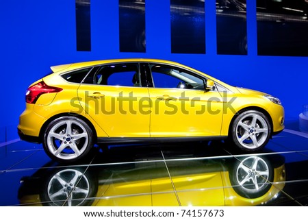 MOSCOW, RUSSIA - AUGUST 25:  Yellow car Ford Focus at Moscow International exhibition InterAuto on August 25, 2010 in Moscow, Russia. - stock photo