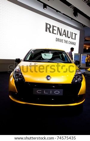 MOSCOW, RUSSIA - AUGUST 25:  Yellow car Renault Clio on display at the Moscow International exhibition InterAuto on August 25, 2010 in Moscow, Russia. - stock photo