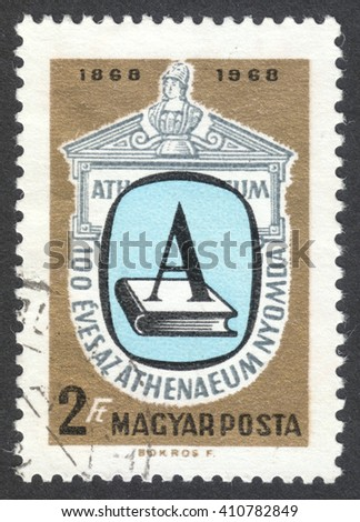 MOSCOW, RUSSIA - CIRCA APRIL, 2016: a post stamp printed in HUNGARY shows a book and a letter A, dedicated to the 100th Anniversary of the Athenaeum Press, Budapest, circa 1969 - stock photo