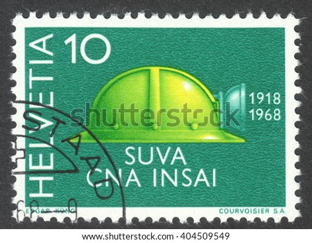 MOSCOW, RUSSIA - CIRCA APRIL, 2016: a post stamp printed in SWITZERLAND shows a helmet, circa 1968 - stock photo