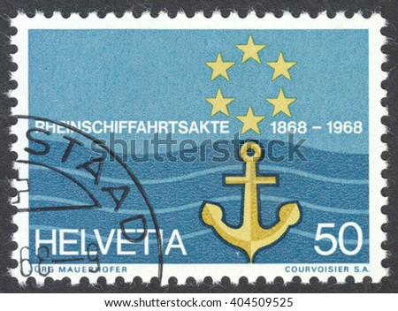 MOSCOW, RUSSIA - CIRCA APRIL, 2016: a post stamp printed in SWITZERLAND shows flag of Rhine Navigation Committee, circa 1968 - stock photo