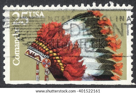 "MOSCOW, RUSSIA - CIRCA APRIL, 2016: a post stamp printed in the USA shows an indian headdresses of the tribe Comanche, the series "" Indian Headdresses"", circa 1990 - stock photo"