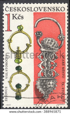 "MOSCOW, RUSSIA - CIRCA FEBRUARY, 2016: a post stamp printed in CZECHOSLOVAKIA shows gold earrings (the 8th-9th Century), the series ""Archaeological Discoveries in Bohemia and Slovakia"", circa 1969 - stock photo"