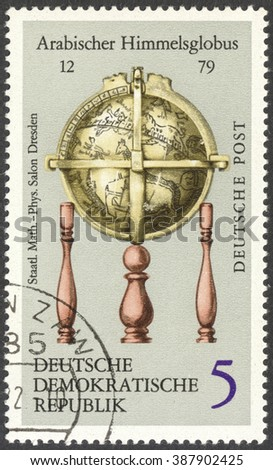 "MOSCOW, RUSSIA - CIRCA FEBRUARY, 2016: a post stamp printed in DDR shows Arab Celestial Globe, the series ""Globes"", circa 1972 - stock photo"