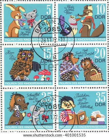 """MOSCOW, RUSSIA - CIRCA FEBRUARY, 2016: a post stamp printed in DDR shows scenes from the cartoons, the series """"Cartoons"""", circa 1972 - stock photo"""