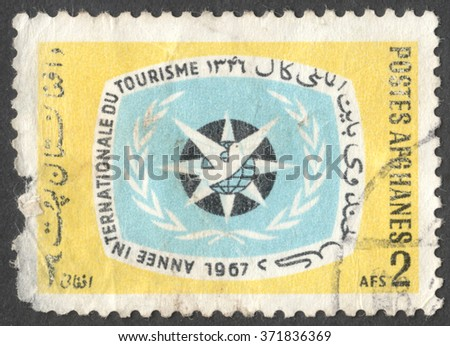 MOSCOW, RUSSIA - CIRCA JANUARY, 2016: a post stamp printed in AFGHANISTAN devoted to International Tourism Year, circa 1967 - stock photo