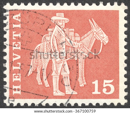 """MOSCOW, RUSSIA - CIRCA JANUARY, 2016: a post stamp printed in SWITZERLAND shows a mounted postman and a pack animal, the series """"Postal History and Architectural Monuments"""", circa 1960 - stock photo"""