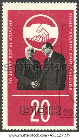 "MOSCOW, RUSSIA - CIRCA JULY, 2016: a stamp printed in DDR shows W. Pieck and O. Grotewohl, the series ""The 20th Anniversary of the Socialist Unity Party"", circa 1966 - stock photo"