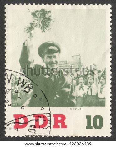 """MOSCOW, RUSSIA - CIRCA MAY, 2016: a post stamp printed in DDR shows a portrait of the Soviet Cosmonaut Gherman Titov, the series """"Titov's Visit to DDR"""", circa 1961 - stock photo"""