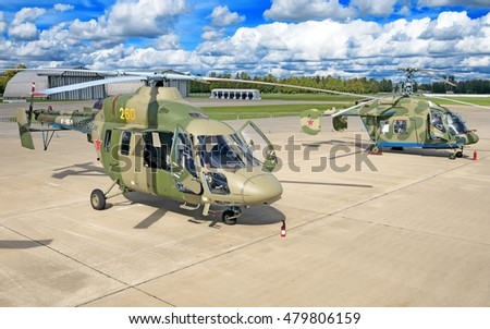 MOSCOW, RUSSIA - CIRCA SEPTEMBER, 2016: Russian Air Force Ansat  Kamov Ka-226 multi purpose light military combat helicopter in camouflage parked on concrete apron detail exterior panoramic wide view