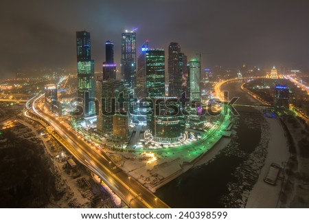 MOSCOW, RUSSIA - DEC 02, 2014: Building of Moscow International Business Center (Moscow-City) on the background of the city at night in winter  - stock photo