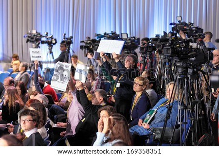 MOSCOW, RUSSIA - DEC 19, 2013: Journalists, the participants of the annual press conference of the President of Russia Vladimir Putin, in Center of international trade - stock photo