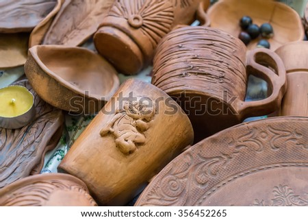 MOSCOW, RUSSIA - DECEMBER 27, 2015: Christmas exhibition at the Central Telegraph, Moscow, Tverskaya street. Pottery, handmade. Cups.  - stock photo