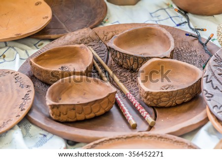 MOSCOW, RUSSIA - DECEMBER 27, 2015: Christmas exhibition at the Central Telegraph, Moscow, Tverskaya street. Pottery, handmade, chinese chopsticks. - stock photo