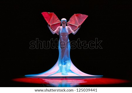 MOSCOW, RUSSIA - DECEMBER 08: Dancer in mask on Charity concert in Nations Theater in Moscow, Russia, December 08, 2012 - stock photo