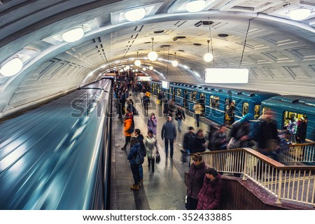 MOSCOW, RUSSIA - DECEMBER 6, 2015: Inside a Lenin Library metro station at rush hour. Unidentified people at the platform with moving trains - stock photo