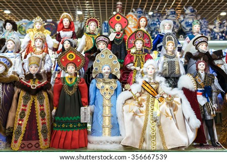 MOSCOW, RUSSIA - DECEMBER 11, 2015: Moscow souvenirs, traditional handmade rag toys puppets dolls in folk costumes (traditional Russian clothing) in Central Children's Store on Lubyanka - stock photo