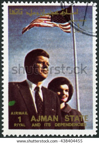 MOSCOW, RUSSIA - FEBRUARY 13, 2016: A stamp printed in Ajman shows John F. Kennedy (1917-1963) and wife Jacqueline Lee Jackie Bouvier (1929-1994), series famous men and women, 1972 - stock photo