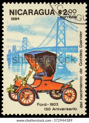 """MOSCOW, RUSSIA - FEBRUARY 06, 2016: A stamp printed in Nicaragua shows old car Ford (1903), series """"The 150th Anniversary of the Birth of Gottlieb Daimler, 1834-1900 -  Vintage Cars"""", circa 1984 - stock photo"""