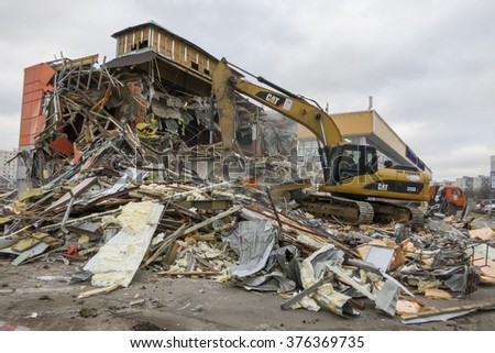 Moscow, Russia - February 11, 2016: Excavator destroys cafe