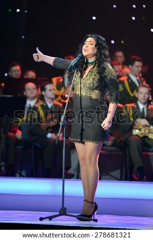 "MOSCOW, RUSSIA - FEBRUARY 27, 2014: Lolita - Russian singer, actress, TV presenter and Director. Concert in the State Kremlin Palace ceremony ""Shield and rose""."