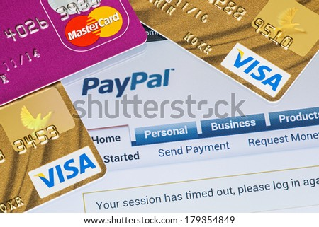 Moscow, Russia - February 27, 2014: Online shopping paid via Paypal payments using plastic cards Visa and Mastercard. PayPal is a popular and international method of money transfer via the Internet. - stock photo
