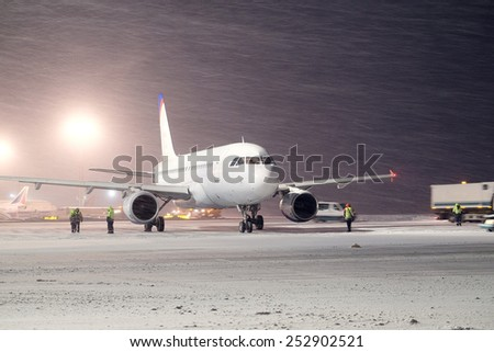 Moscow, Russia, February, 09,2015: plane parked at the airport in winter - stock photo