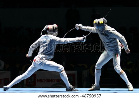 MOSCOW, RUSSIA - FEBRUARY 13: Rares Dumitrescu (ROU) and Zsolt Nemcsik (HUN) compete at the 2010 RFF Moscow Saber World Fencing Tournament, February 13, 2010 in Moscow, Russia. - stock photo