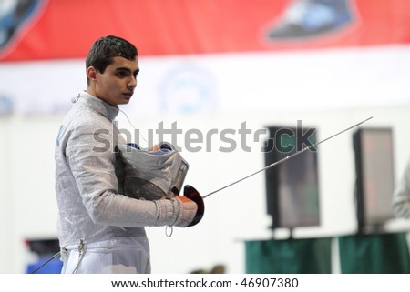 MOSCOW, RUSSIA - FEBRUARY 14: Rares Dumitrescu (ROU) compete at the 2010 RFF Moscow Saber World Fencing Tournament, February 14, 2010 in Moscow, Russia.