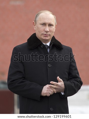 MOSCOW, RUSSIA - FEBRUARY 23: Russian President Vladimir Putin attends a wreath-laying ceremony at the Tomb of the Unknown Soldier, February 23, 2013 in Moscow. - stock photo