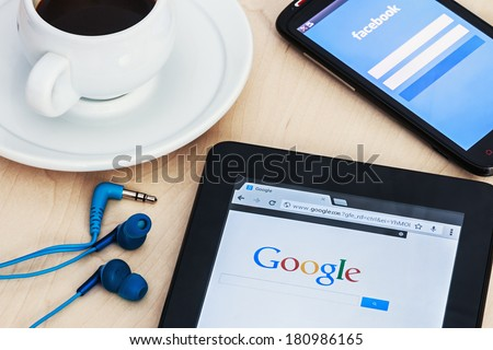 Moscow, Russia - February 27, 2014: Search engine Google and the entrance to the Facebook social network. Google and Facebook are the most advanced Internet companies in the world. - stock photo