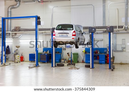 Moscow, Russia - February 07, 2016: The car on the lift. Change engine oil and transmission inspection