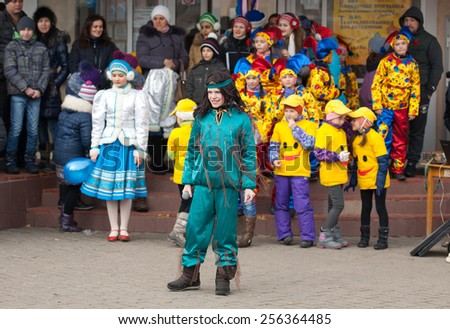 MOSCOW, RUSSIA - FEBRUARY 22: Unidentified girl in Brownie costume on Russian religious and folk holiday Maslenitsa near Culture center Peresvet on February 22, 2015, Russia - stock photo