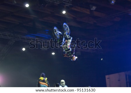 MOSCOW, RUSSIA - FEBRUARY 11: Unidentified motorbike rider performs at festival of Extremals sports at Lugniki on February 11, 2012 in Moscow, Russia