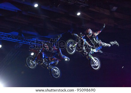 MOSCOW, RUSSIA - FEBRUARY 11: Unidentified motorbike riders perform at festival of Extremals sports at Lugniki on February 11, 2012 in Moscow, Russia