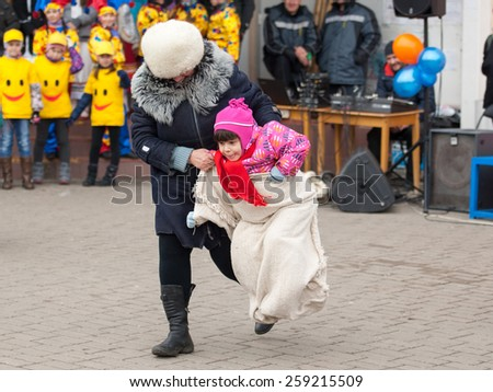 MOSCOW, RUSSIA - FEBRUARY 22: Unidentified people run in sack on Russian religious and folk holiday Maslenitsa near Culture center Peresvet on February 22, 2015, Russia - stock photo