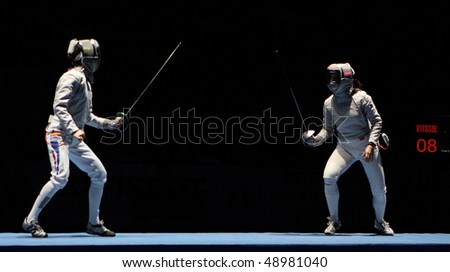 MOSCOW, RUSSIA - FEBRUARY 16: Women's national teams of France and Russia compete at the 2010 RFF Moscow Saber World Fencing Tournament, February 16, 2010 in Moscow, Russia. - stock photo