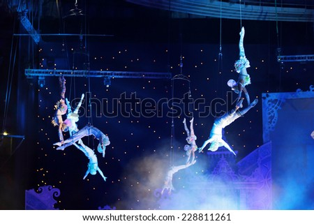"MOSCOW, RUSSIA - JAN 06, 2013: Children's new year performance ""Circus Santa Claus II - Olympic New Year"" in Olympic Stadium (sport complex). The performance of the trapeze artists - stock photo"
