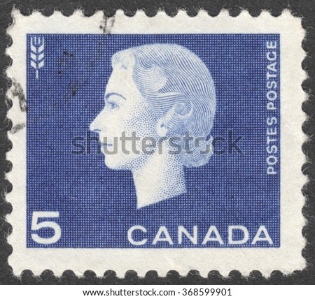 """MOSCOW, RUSSIA - JANUARY, 2016: a post stamp printed in CANADA shows a portrait of Queen Elizabeth II, the series """"Queen Elizabeth II"""", circa 1962 - stock photo"""