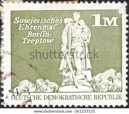"MOSCOW, RUSSIA - JANUARY, 2016: a post stamp printed in DDR shows the Soviet War Memorial, Treptow, Berlin, the series ""Buildings"", circa 1973 - stock photo"