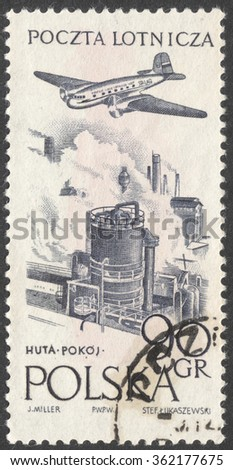 "MOSCOW, RUSSIA - JANUARY, 2016: a post stamp printed in POLAND shows an airplane over a plant, the series ""Airplane over Towns and Landscapes"", circa 1957"