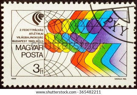 MOSCOW, RUSSIA - JANUARY 21, 2016: a stamp printed in Hungary shows poster of running athletes, devoted to the World Athletics Championships in Budapest 1989, circa 1989 - stock photo