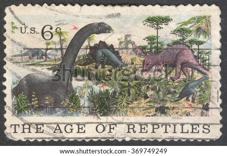 """MOSCOW, RUSSIA - JANUARY 2016: a stamp printed in the USA shows Apatosaurus, Stegosaurus & Allosaurus, the series """"The 100th Anniversary of the American Museum of Natural History, New York, circa 1970 - stock photo"""