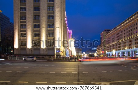 MOSCOW, RUSSIA - JANUARY 04, 2018:  Christmas (New Year) holidays illumination and Building of The State Duma of the Federal Assembly of Russian Federation at night, Moscow, Russia